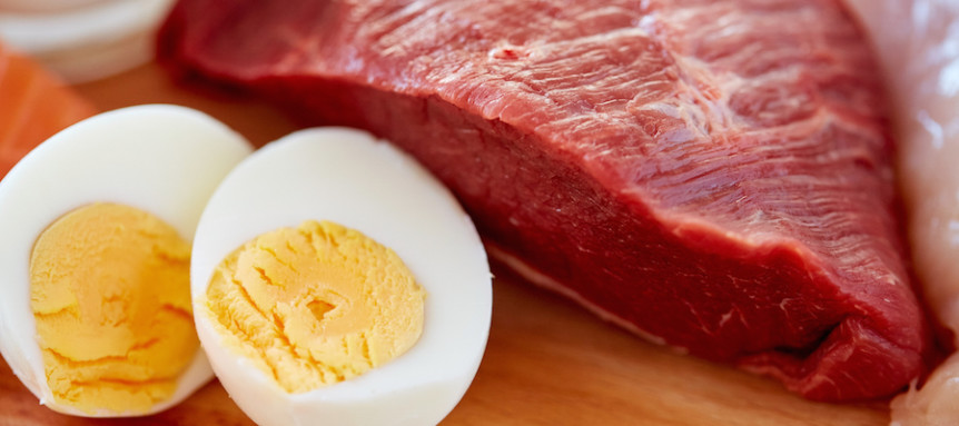 healthy lifestyle, culinary, cooking and diet concept - close up of red meat fillets and boiled eggs